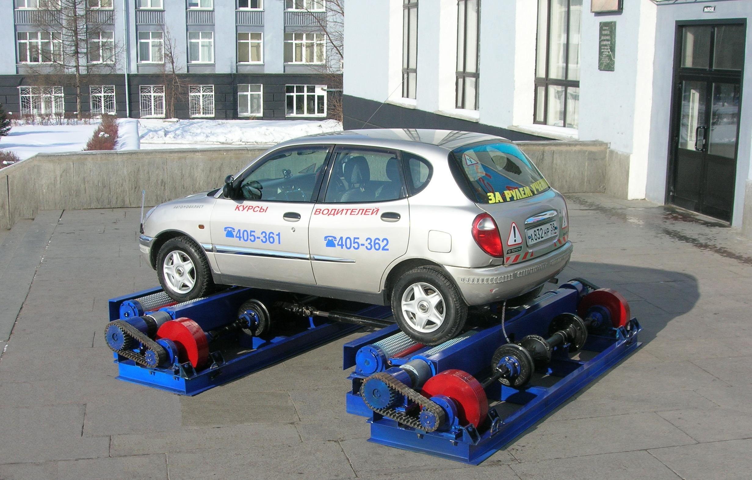 Стенд для диагностирования тормозных систем, ABS, автоматичсеских трансмиссий и противобуксовочных систем автомобиля